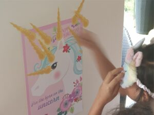 Pin the horn on the unicorm game unicorn party activity